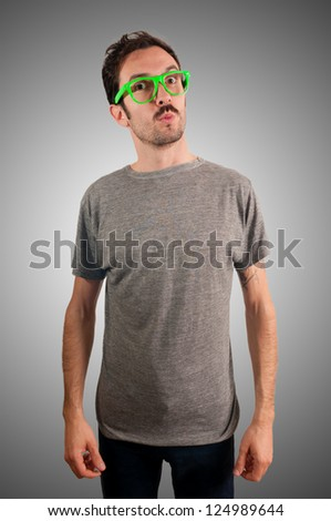 guy with green eyeglasses and mustache on green background - stock photo