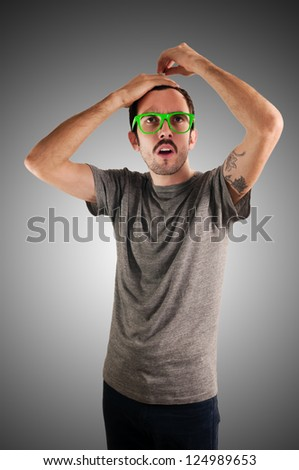 guy with green eyeglasses and mustache on green background