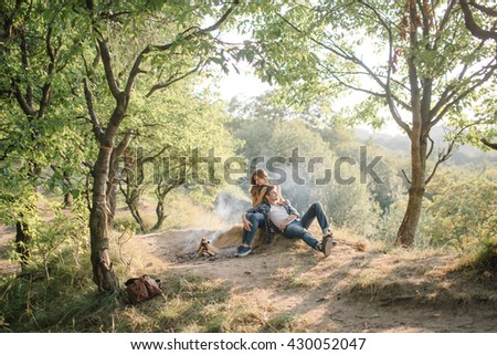 guy with his beloved have resting  by the fire
