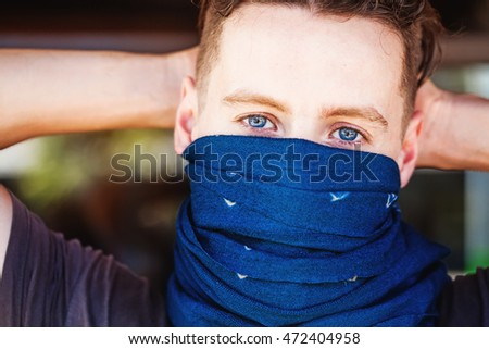 guy with his face half covered with scarf
