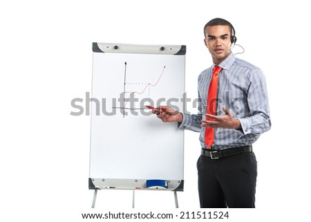 guy with presentation gesturing with hands. young african man standing in red tie and with white board - stock photo