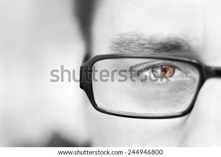Guy with the glasses and green eyes  black and white halfprofile man