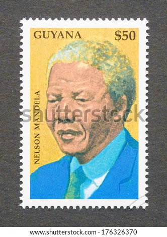 GUYANA - CIRCA 1999: a postage stamp printed in Guyana showing an image of Nelson Mandela circa 1999.  - stock photo