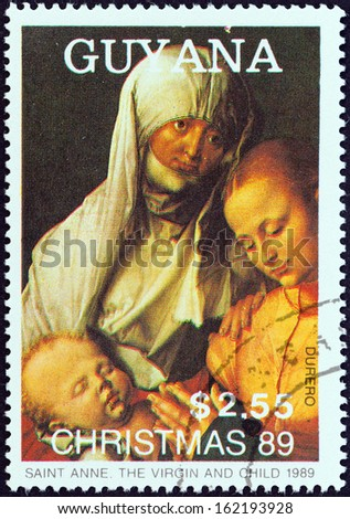 """GUYANA - CIRCA 1989: A stamp printed in Guyana from the """"Christmas. Paintings"""" issue shows Saint Anne, The Virgin and Child (Albrecht Durer), circa 1989.  - stock photo"""