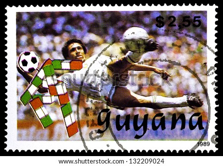 "GUYANA - CIRCA 1989: A stamp printed in Guyana shows soccer player, without inscription, from the series ""World Cup Soccer Championships, Italy, 1990"", circa 1989 - stock photo"