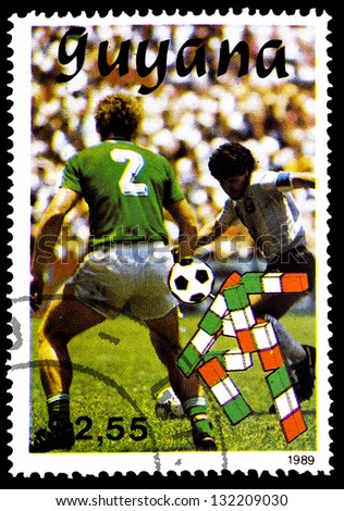 "GUYANA - CIRCA 1989: A stamp printed in Guyana shows soccer players, without inscription, from the series ""World Cup Soccer Championships, Italy, 1990"", circa 1989 - stock photo"