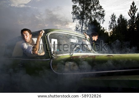 guys and car full of smoke