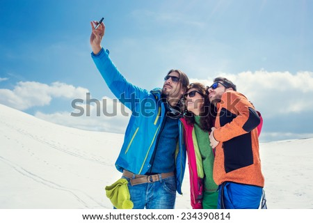 guys having a selfie on the snow - stock photo
