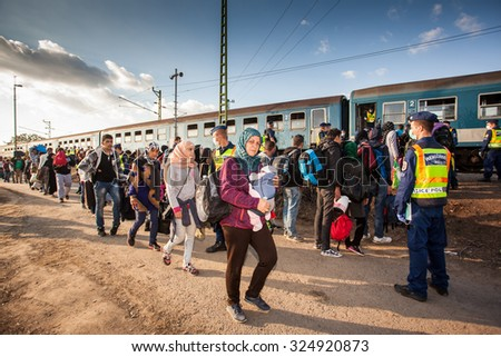 GYEKENYES- OCTOBER 5 : War refugees at the Gyekenyes Zakany Railway Station on 5 October 2015 in Gyekenyes, Hungary. Refugees are arriving constantly to Hungary on the way to Germany.