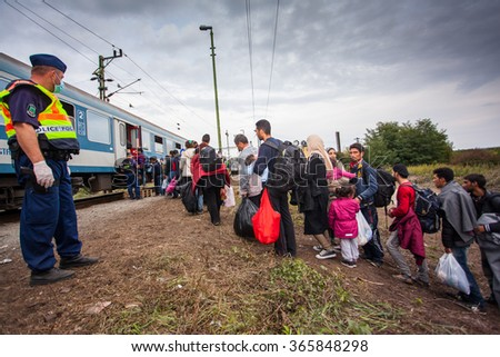 GYEKENYES- OCTOBER 6 : War refugees at the Gyekenyes Zakany Railway Station on 6 October 2015 in Gyekenyes, Hungary. Refugees are arriving constantly to Hungary on the way to Austria. - stock photo