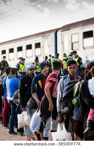 GYEKENYES- OCTOBER 10 : War refugees at the Gyekenyes Zakany Railway Station on 5 October 2015 in Gyekenyes, Hungary. Refugees are arriving constantly to Hungary on the way to Germany. - stock photo