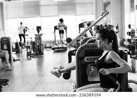 Gym fitness club indoor with young women training weights with hands - stock photo