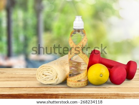 Gym. Fitness dumbbells water and fruits  isolated on white - stock photo