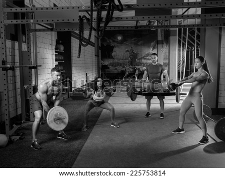 gym group weight lifting workout men and girls exercise - stock photo