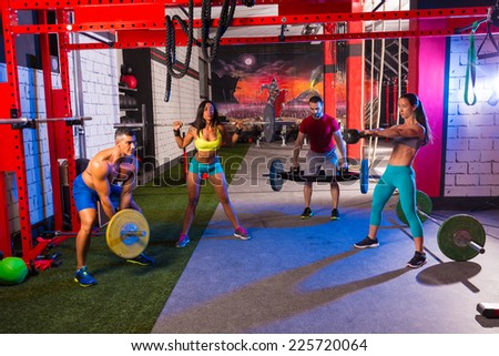 gym group weightlifting workout men and girls exercise - stock photo