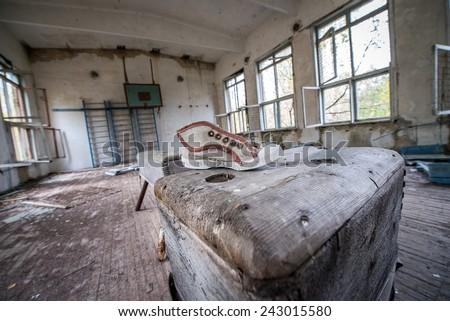 gym in ruined school in Illinci village in Chernobyl Nuclear Power Plant Zone of Alienation, Ukraine - stock photo