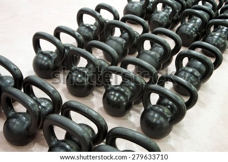 gym, lot of black catballs for bodybilding  - stock photo