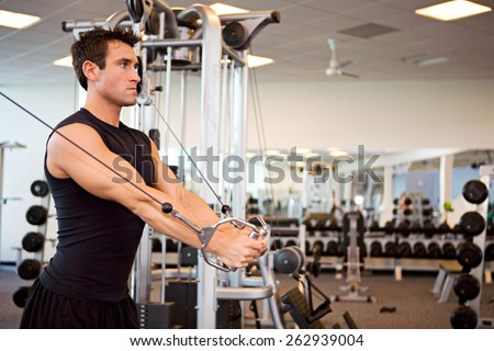Gym: Man Gets Arm Workout During Session - stock photo