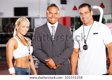 gym manager and trainers group portrait - stock photo