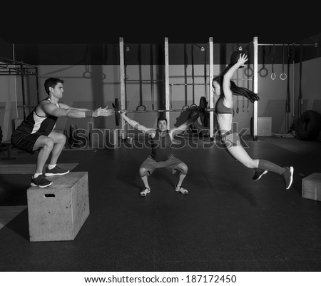 gym people group workout barbells slam balls and jump exercises - stock photo