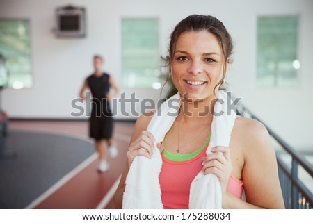 Gym: Pretty Woman Taking a Break By Jogging Track - stock photo