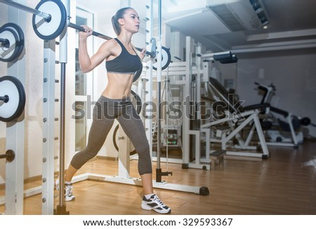 Gym.Sporty girl posing