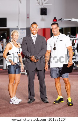 gym staff full length portrait - stock photo