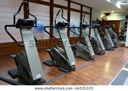 gym with row of stair steppers