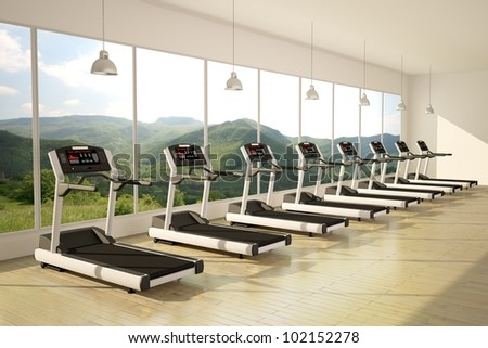 Gym with windows and running machines with wooden floor - stock photo