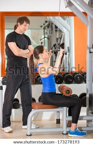 gym woman personal trainer man with weight training