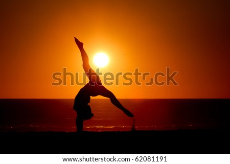 gymnast in sunset