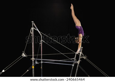 Uneven Parallel Bars Gymnastics Gymnast on Uneven Parallel