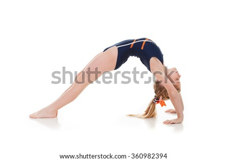 Gymnast: Side View Of Young Girl Doing A Backbend Bridge - stock photo