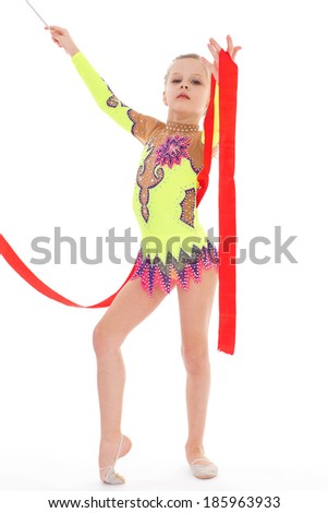 Gymnast, sport,kids,girl,kid,child- Charming girl gymnast with ribbon. Isolated on white background.