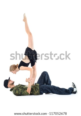 Gymnast stands on rapper chest and looks into his eyes isolated on white background. - stock photo