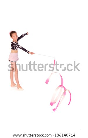 gymnast with ribbon on a white background - stock photo