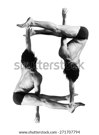 Gymnasts figures on a white background.Athletes.Handstand.Black and white image - stock photo