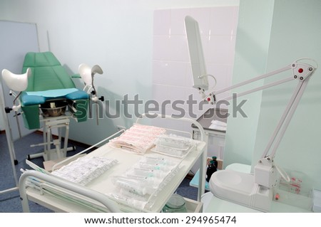 Gynecological chairs and table manipulation in the doctor's office. - stock photo