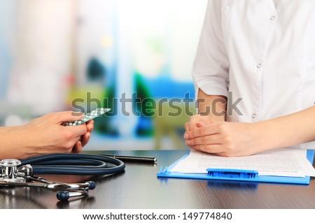 Gynecologist appoints hormone pills patient - stock photo