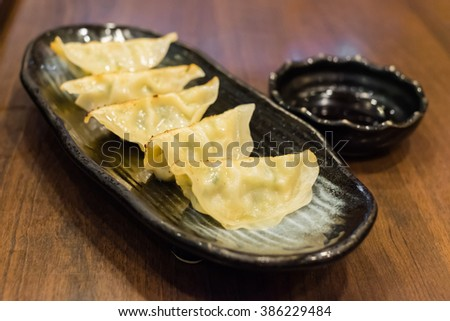 Gyoza dumpling appetizers, the popular japanese food with soy dipping sauce. - stock photo