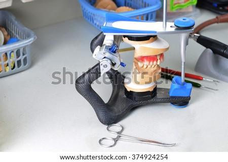gypsum model of jaw and basic dentist tools - stock photo