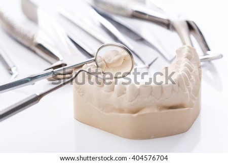 Gypsum model of jaws and  different dental tools - stock photo