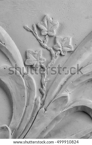 gypsum plaster ornaments on a black background