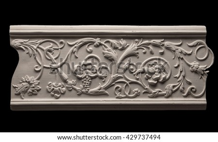 gypsum products, pattern, ornament on a black background - stock photo