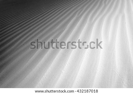 Gypsum sand dunes creating a ripple effect at White Sands National Monument in New Mexico - stock photo