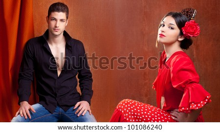 Gypsy flamenco dancer couple from Spain with red rose and spanish back comb peineta