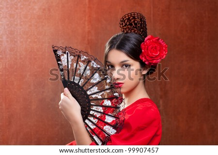 Gypsy flamenco dancer Spain girl with red rose spanish hand fan and peineta comb