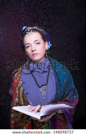 Gypsy girl. Portrait of young woman in ethnic cosrume.