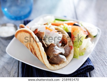 gyro with greek salad and tzatziki sauce - stock photo