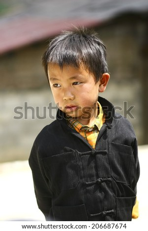 HA GIANG, VIET NAM - MAY 9, 2010: Unidentified traditionally dressed boy of Hmong ethnic minority tribe in Viet Nam. Hmong people are known for their indigo-dyed costumes and ornate silver jewellery. - stock photo